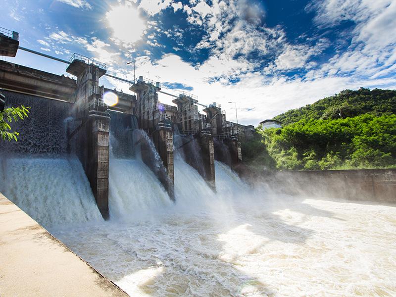 Water flows through a dam.